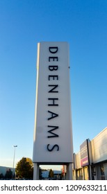 STEVENAGE, UK - OCTOBER 22, 2018: Debenhams signage tower in the Roaring Meg retail park at Stevenage Hertfordshire