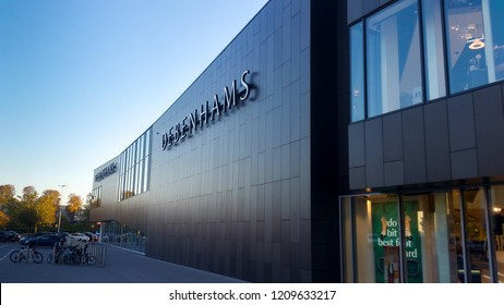 STEVENAGE, UK - OCTOBER 22, 2018: Debenhams elevation and carpark in the Roaring Meg retail park at Stevenage Hertfordshire