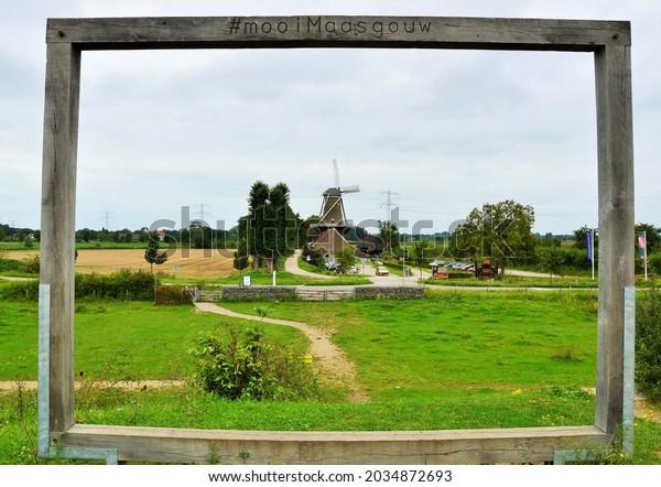 Stevensweert,Netherlands,September 2021, a frame of wood for landcape with a mill