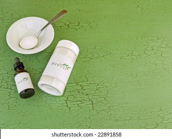 Stevia, natural zero calorie sweetener on green with copy space. The generic labels were made for the photo shoot, no infringement issues.