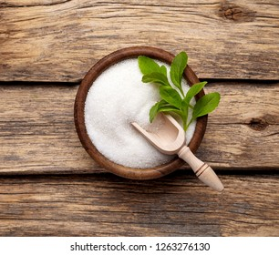 Stevia rebaudiana, sweet leaf sugar substitute isolated in wooden bowl on wooden background