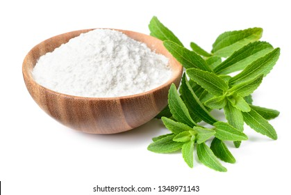 stevia sugar in the wooden bowl, with fresh stevia leaves, isolated on white background