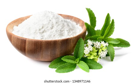 stevia sugar in the wooden bowl, with fresh stevia leaves and flowers, isolated on white background