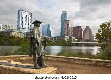Stevie Ray Vaughan statue in front of downtown Austin and the Colorado River from Auditorium Shores, Austin , Texas, USA