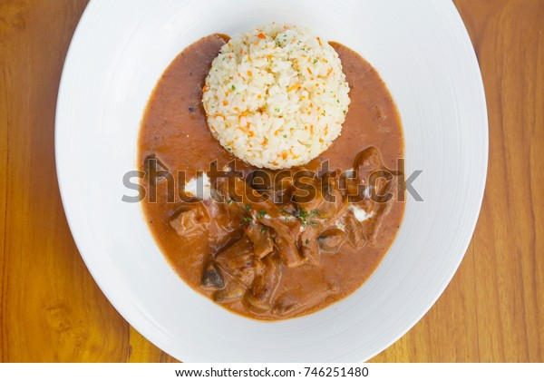 Stew served with rice