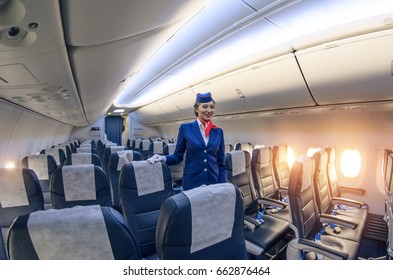 Stewardess and passenger lounge inside the Boeing 737-800. Russia, Saint-Petersburg, November 2016
