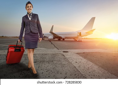 stewardess woman at morning time on airport and background with plane