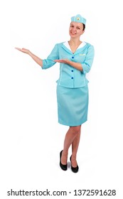 Stewardesse - Charming and smiling Stewardess Dressed In Blue Uniform Holding In Hand. Isolated on white background