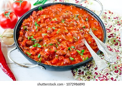 Stewed beans with tomatoes and vegetables