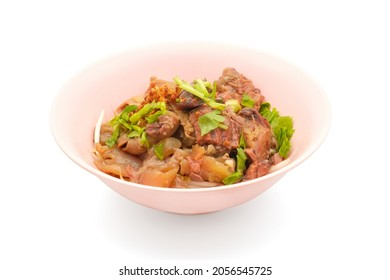 Stewed beef pork in bowl without soup isolated on white background with clipping path. Set of local steamed food dine in.