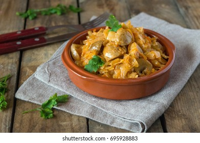Stewed cabbage with mushrooms champignons, snack of Ukrainian cuisine