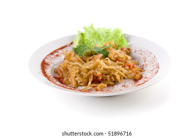 stewed cabbage on white plate