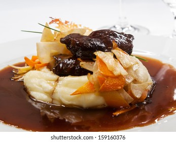 Stewed calfs cheek on red wine with mashed potatoes