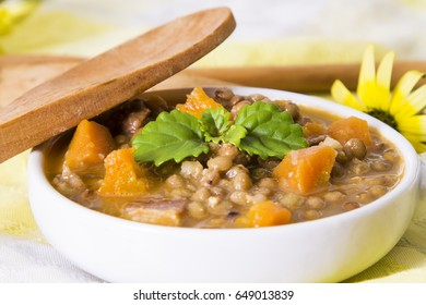 Stewed lentils on table with tablecloth