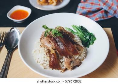 Stewed pork leg on rice with sauce.Thai food