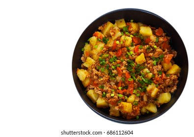 stewed potato with minced meat in a frying pan. top view. isolated on white