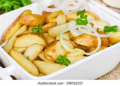 Stewed potatoes in a white ceramic bowl