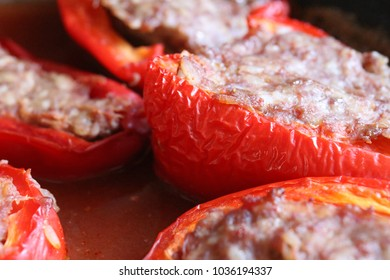 Stewed sweet peppers stuffed with meat and rice in tomato sauce
