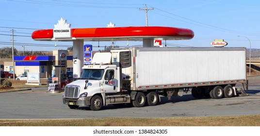 Stewiacke, Canada - April 18, 2019: Petro-Canada fuel station and TRA Semi-trailer truck. Petro-Canada was an oil and gas industry crown corporation of Canada.