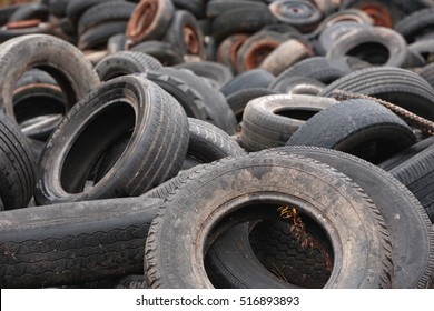 STEWIACKE, CANADA - NOVEMBER 15, 2016: Discarded and worn out tires for recycling.