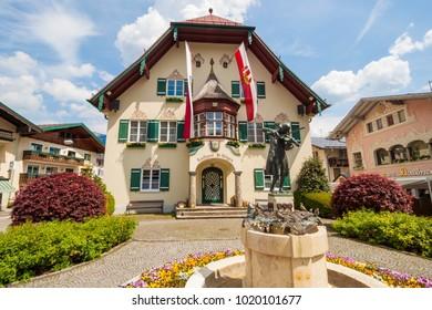 St.Gilgen, Austria - May 23, 2017: Statue of young Wolfgang Amadeus Mozart in front of townhall on Mozartplatz in alpine village St. Gilgen, Austria
