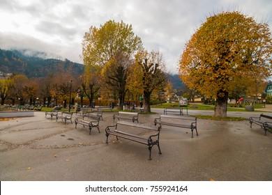 St.Gilgen, Austria - November 3, 2017: Lakeside promenade near Wolfgangsee lake in austrian alpine village St.Gilgen on cloudy autumn day.
