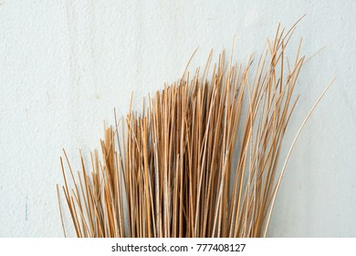 Stick Broom or Coconut Broom Head on White Plain Wall