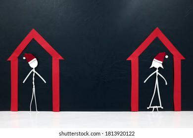 Stick man couple figure wearing santa hat inside a red house. Isolation and stay home concept during covid Christmas.
