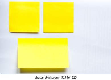 stick note isolated white background.close up of a vintage note paper.Vintage yellow  note paper.three yellow sticker on a white background, blank yellow adhesive note on white background with shadow