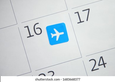 Sticker with the image of airplane to booking a flight in calendar. Concept of travel