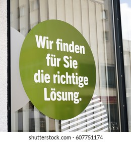 """Sticker on a shop window with the words """"We find the right solution for you"""""""