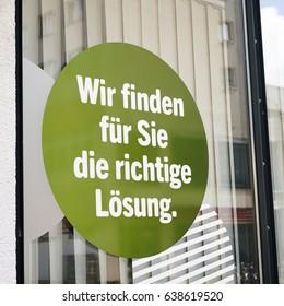 Sticker on a shop window with the words: Wir finden für Sie die richtige Lösung, translation: We find the right solution for you
