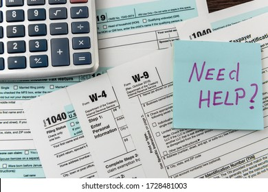Sticker with text Need Help and 1040 tax form, pen and calculator. Deadline. Paperwork