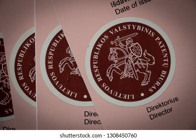 Stickers on Lithuanian Patent office certificates of trademark registration, issued in 2018. The certificates contain Lithuanian coat of arms. Image was made on 9/2/2019.