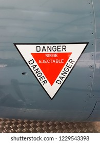 stickers sign on plane write in french siège éjectable danger means ejection seat danger