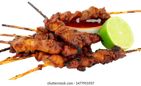 Sticky chicken skewers with chilli sauce dip isolated on a white background