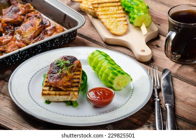 Sticky chicken with spicy sauce, toasted panini with coarse-grained salt and olive oil plus cucumber kebab