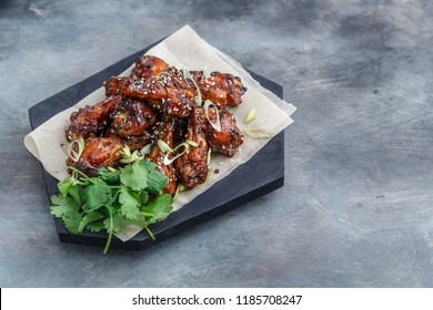 Sticky chicken wings with sesame, spicy sauce, copy space