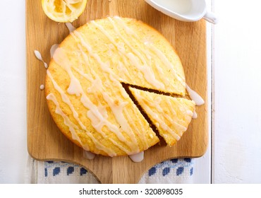 Sticky lemon cake with icing drizzle top view