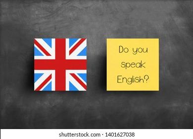 Sticky note on blackboard, Do you speak English?