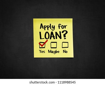 A sticky note on blackboard that says 'Apply for Loan?'