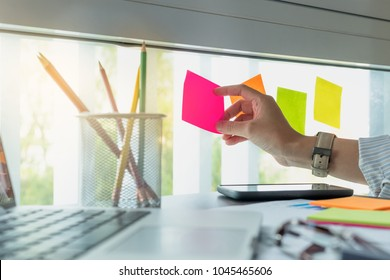 Sticky note paper reminder schedule board. Accountant or business use post it notes to share idea on sticky note. Accounting concept