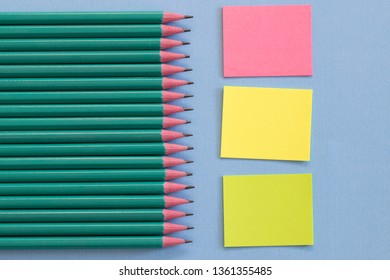 Sticky note and pencils background with clipping path.
