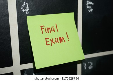 Sticky note remind college student or workers about final exam, new semester, assignment and due date stick at calendar