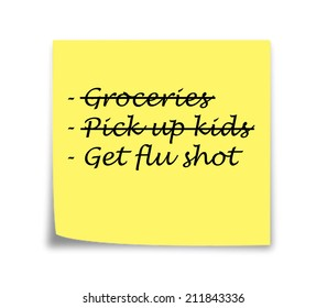 Sticky note reminder to get flu shot, black on yellow