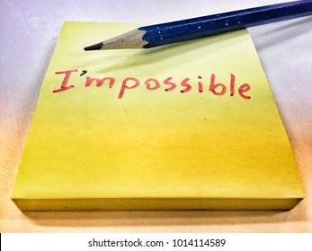 """The sticky note with word """"I'm possible"""" which edit from """"Impossible"""". The image show how to solve the problem by change attitude."""