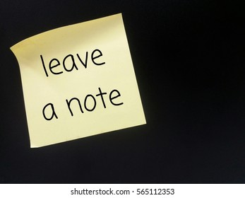 Sticky note with wordings on black background