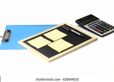 Sticky notes, calculator on blackboard isolated on white background