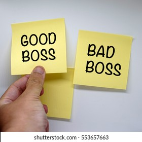 Sticky notes concept of a man hand chooses good boss or bad boss
