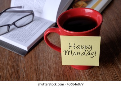 Sticky notes on cup of coffee written Happy Monday! Start a day with positive mindset conceptual.